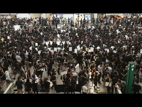 """One of the world's busiest airports canceled all flights after thousands of pro-democracy demonstrators crowded into Hong Kong's main terminal. Meanwhile, Beijing ominously characterized the protest as something approaching """"terrorism."""" (Aug. 12)"""