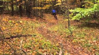 The huge drop shown in this video, among other segments of trail, is located in the Craig Wood Trails.