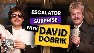 David Dobrik and Jimmy disguise themselves and ride the escalator at The Shops at Columbus Circle in New York City, surprising people with comedicbits, wads of cash, iPads and Apple Watches.  Subscribe NOW to The Tonight Show Starring Jimmy Fallon: http://bit.ly/1nwT1aN   Watch The Tonight Show Starring Jimmy Fallon Weeknights 11:35/10:35c   Get more The Tonight Show Starring Jimmy Fallon: https://www.nbc.com/the-tonight-show   JIMMY FALLON ON SOCIAL Follow Jimmy: http://Twitter.com/JimmyFallon Like Jimmy: https://Facebook.com/JimmyFallon Follow Jimmy: https://www.instagram.com/jimmyfallon/   THE TONIGHT SHOW ON SOCIAL Follow The Tonight Show: http://Twitter.com/FallonTonight Like The Tonight Show: https://Facebook.com/FallonTonight Follow The Tonight Show: https://www.instagram.com/fallontonight/ Tonight Show Tumblr: http://fallontonight.tumblr.com   The Tonight Show Starring Jimmy Fallon features hilarious highlights from the show, including comedy sketches, music parodies, celebrity interviews, ridiculous games, and, of course, Jimmy's Thank You Notes and hashtags! You'll also find behind the scenes videos and other great web exclusives.   GET MORE NBC NBC YouTube: http://bit.ly/1dM1qBH Like NBC: http://Facebook.com/NBC Follow NBC: http://Twitter.com/NBC NBC Instagram: http://instagram.com/nbctv NBC Tumblr: http://nbctv.tumblr.com/   David Dobrik and Jimmy Surprising People with $100 Bills and iPads http://www.youtube.com/fallontonight  #FallonTonight #DavidDobrik #JimmyFallon