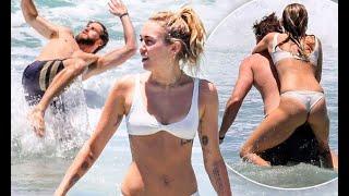 Miley Cyrus in skimpy bikini with Liam Hemsworth at beach