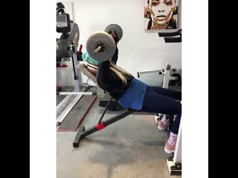 Kylie Grimes doing weight training