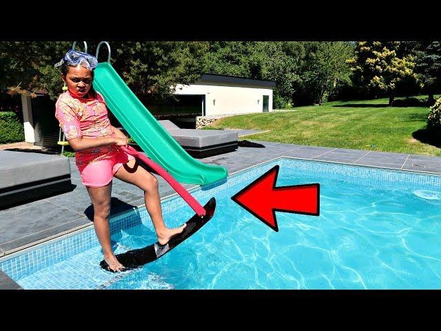 TIANA'S SURFING IN OUR SWIMMING POOL!!