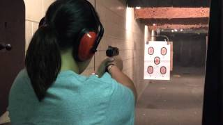 Amanda shooting the 9mm