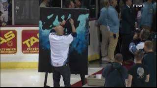 Guy Sings National Anthem While Painting Picture