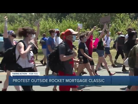 Protesters gather outside Rocket Mortgage Classic tournament