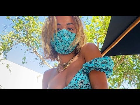 Rita Ora flaunts boobs in world's sexiest bikini as she urges fans to wear masks