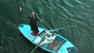 preview picture of video 'Sellers in Esna on river Nile (Egypt) try to sell from their boat to tourists on cruise ships'