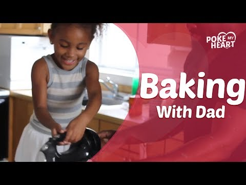 Little Girl Bakes Cookies With Dad