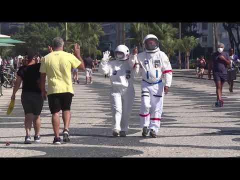 Couple wear space suits to protect themselves from coronavirus in Rio