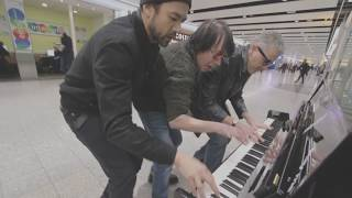 Three Dudes Jam at the Airport Piano