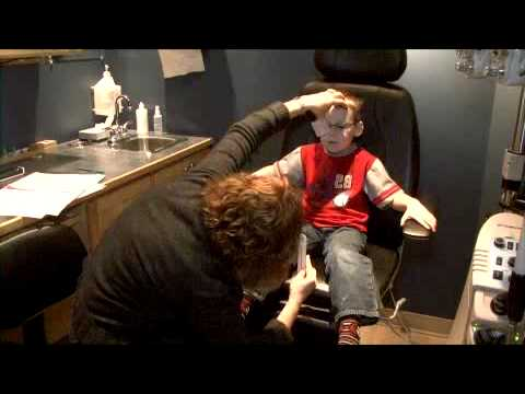 A 5 Year Old Patient Receiving An Eye Exam