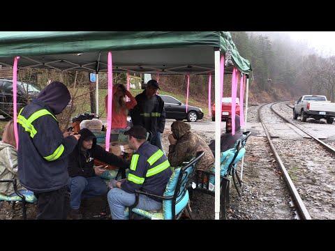 Coal miners continue train blockade while awaiting pay