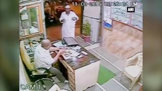 CCTV Footage - A Customer Saves Physically Challenged Mumbai Shopkeeper From Sword Attack