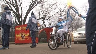 Paralympic Torch Lit by a Huge