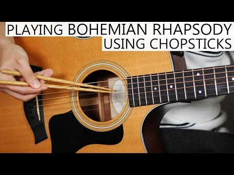 Guy records individual notes and sounds on a guitar then edits them out to create Bohemian Rhapsody.
