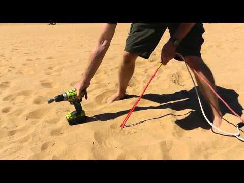 Large plastic Peggy Peg screwed into soft sand