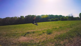 Friend play with fpv drone in a field - freestyle - quarantine flight