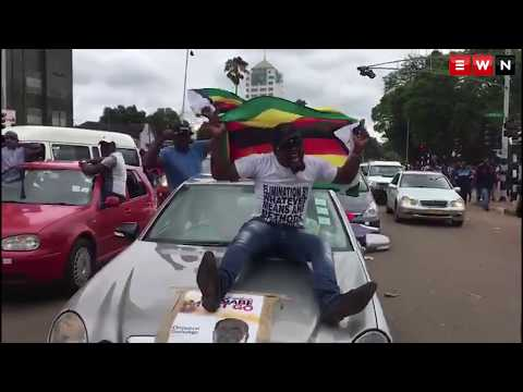Thousands of marchers in Harare call for Mugabe to go
