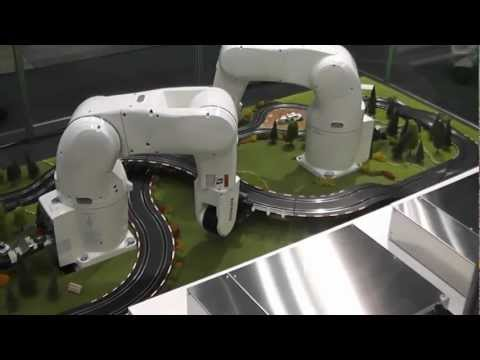 DENSO Robotics – Robots lay out slot-car track
