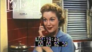 1950s Woman Dreams Of New Kitchen And Living Room
