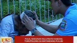 UB: Pulis, nakunan ng litrato habang tumutulong sa matandang pulubi sa Davao City