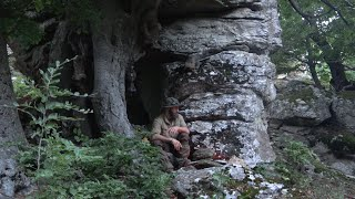 bushcraft in a natural shelter  on the nountain with my puppy, primitive fire, cooking meat etc.