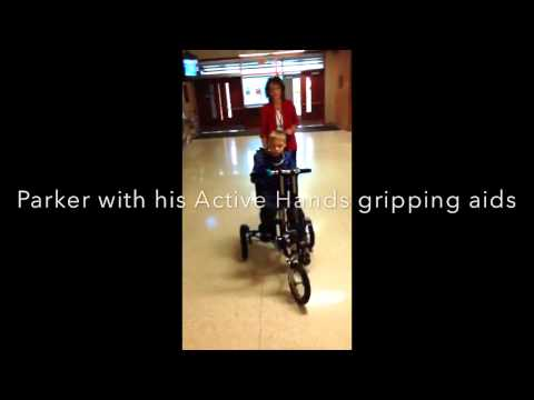 Riding a trike with Micro Cephaly | Active Hands Gripping Aids