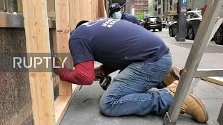 USA: Manhattan stores board up windows after mass looting overnight