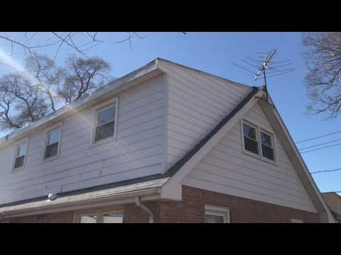 Here our crew removed the old siding, installed insulation board where it was damaged, wrapped over the insulation and replaced the siding. We also installed a new corner edge where the siding was replaced to finish it off.