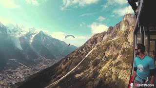 Daredevil parachutes into a moving cable car