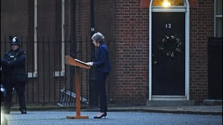 Theresa May holds a news conference