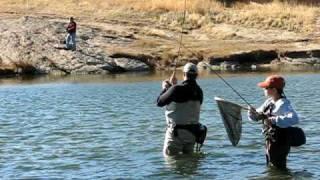 Rob Barringer lands big rainbow trout at Eleven Mile Reservoir