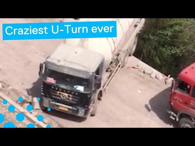 سائق شاحنة يقوم بمخاطرة على طريق جبلي ضيق