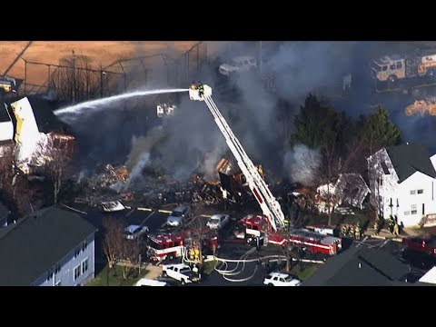 Authorities in Maryland say two people are dead and eight firefighters were hurt in a multi-alarm blaze in which four town houses collapsed. Officials say firefighters could not rescue the two people who died from one town house. (April 4)