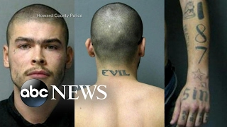Police release new photos of escaped prisoner