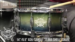 "14""/6.5"" Riverside ash/sapele ""Zebra shell"" snare drum in low tuning."