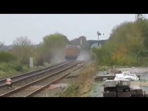 Network Rail Class 97s speed past Gaerwen signal box with RH…