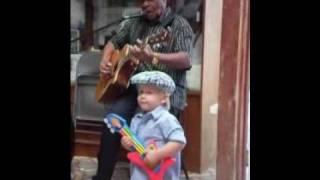 Blues Legend Eddie Cusic, a baby and a Little Tikes guitar