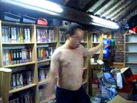 NSFW: Topless Weirdo Shows Off His Neo-Geo Collection