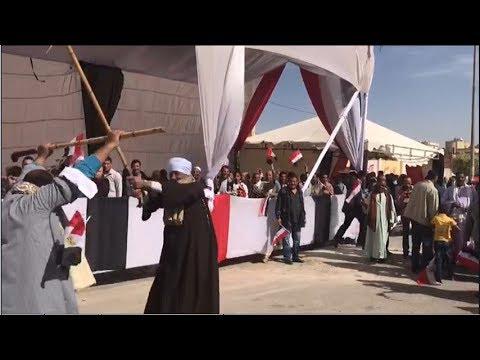 إقبال ورقص عدد من الناخبين أمام اللجان بالتجمع الخامس