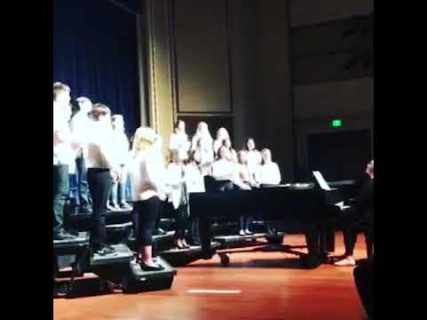 "Ms Allen directing her middle school choir in ""Seasons of Love"" 2018."