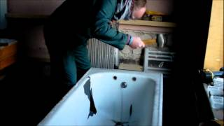 how to remove a cast iron tub