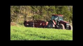 CaseIH MXM140 Spreading Manure with NH195