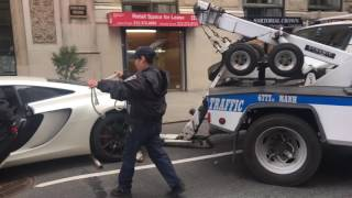 McLaren towed by NYPD traffic