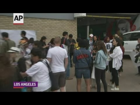 Fans celebrated Michael Jackson's life by marching on Hollywood Boulevard to his Walk of Fame star where they chanted and sang. (June 26)