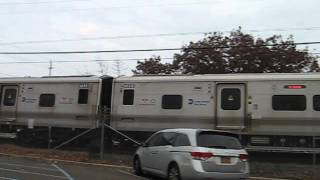 preview picture of video 'Long Island Rail Road train along Railroad Avenue (Woodmere)'
