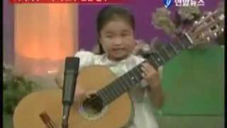 Little fingers on the guitar