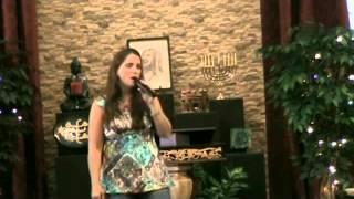"Asha Lightbearer, singing ""Spirit Give Me Faith"""