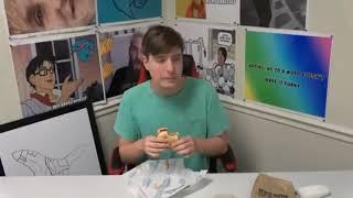 MrBeast throws a burger at Tyler