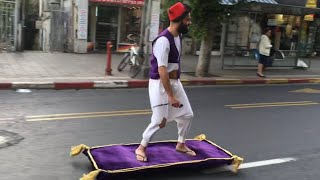 Guy Rides Magic Carpet down Street